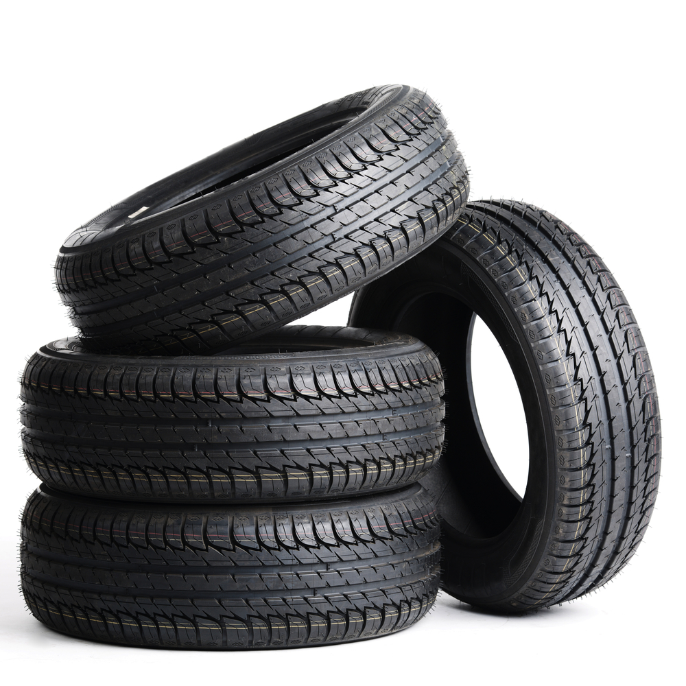 a pile of tires with a white background