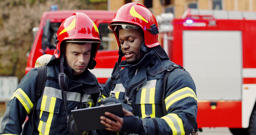 two firefighters working together