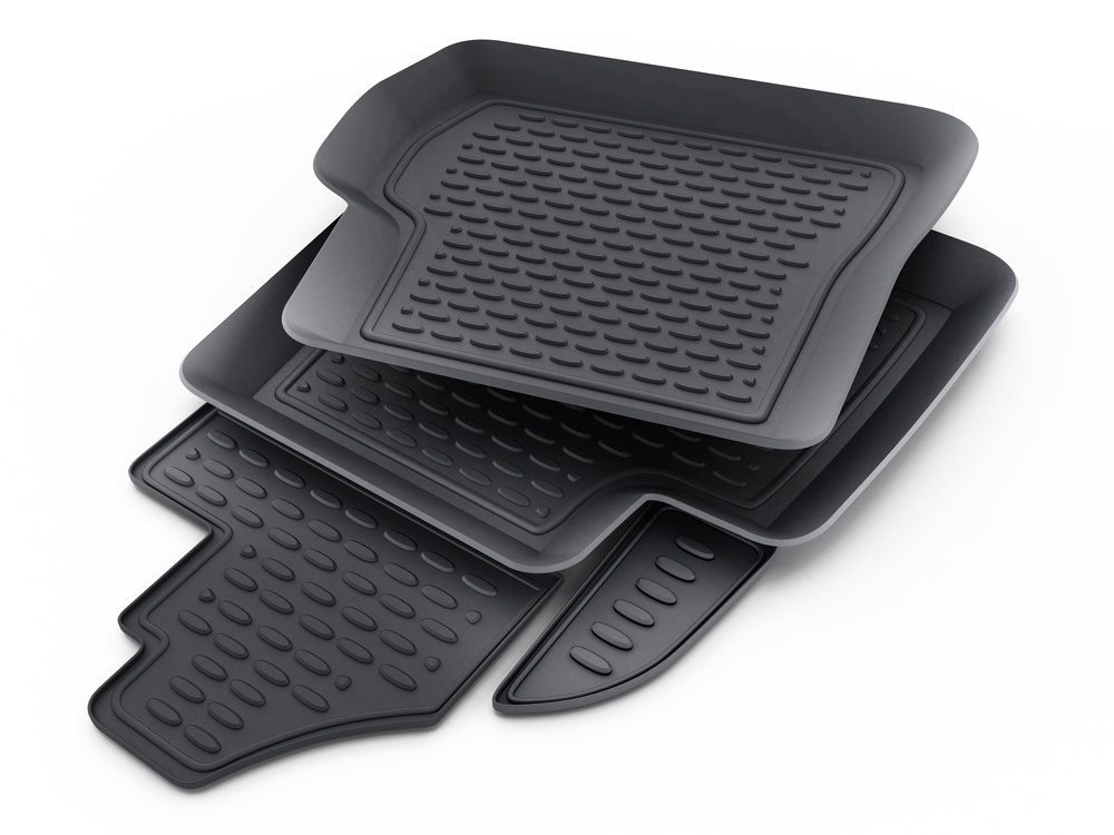 Image of a stack of black rubber car mats