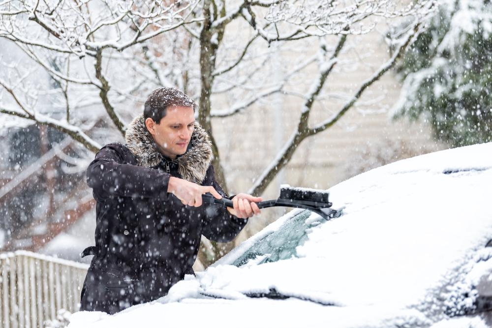 man using a makeshift scraper