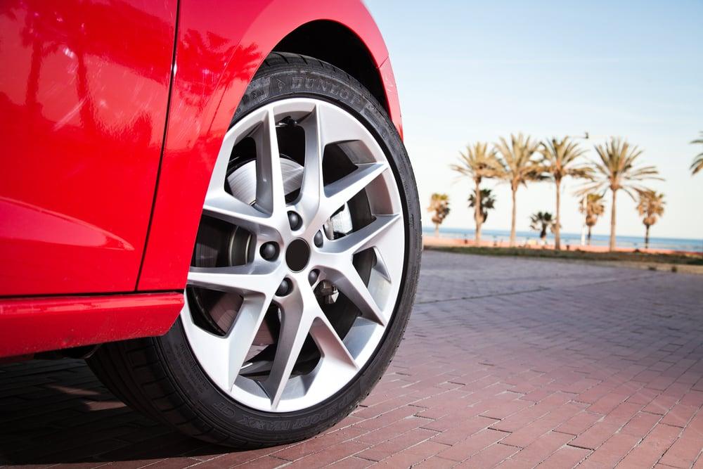 close up car wheel near beach