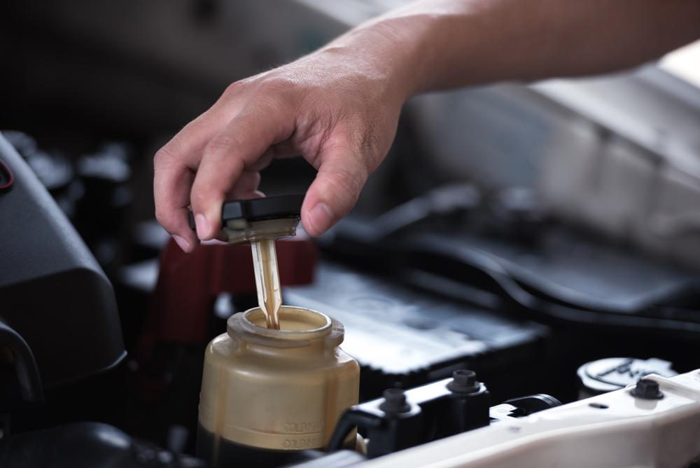 power steering fluid being added