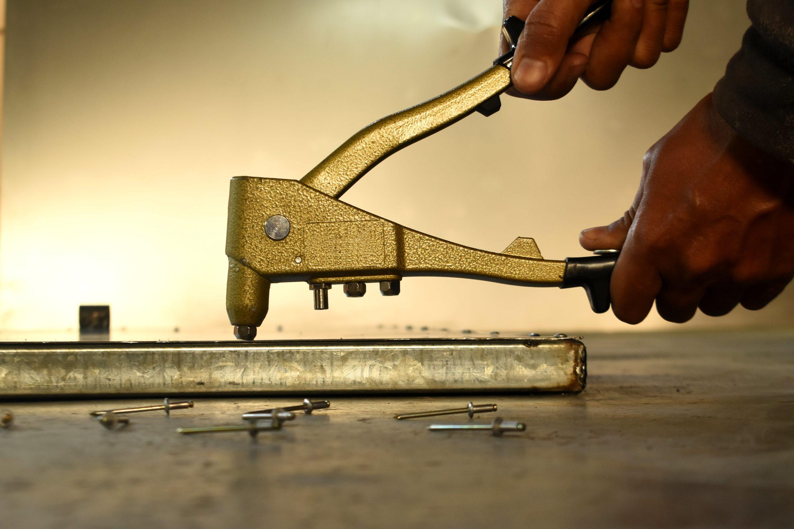rivet gun being used