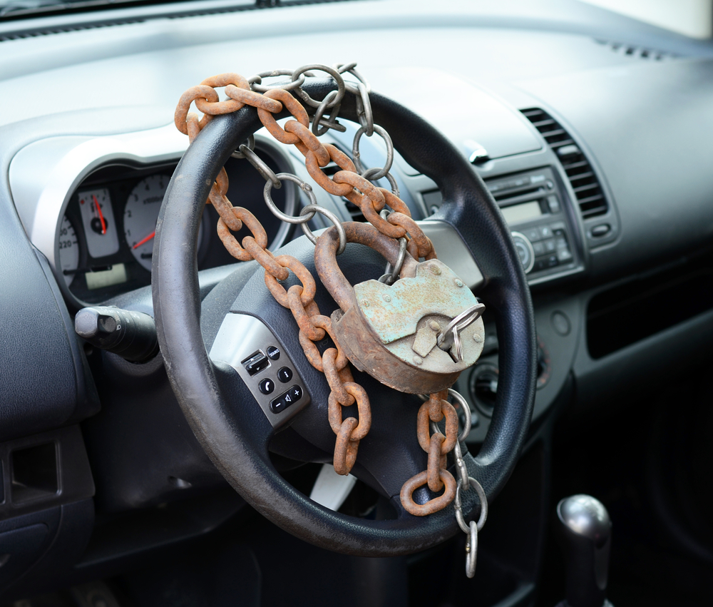 steering wheel covered with locks and chains