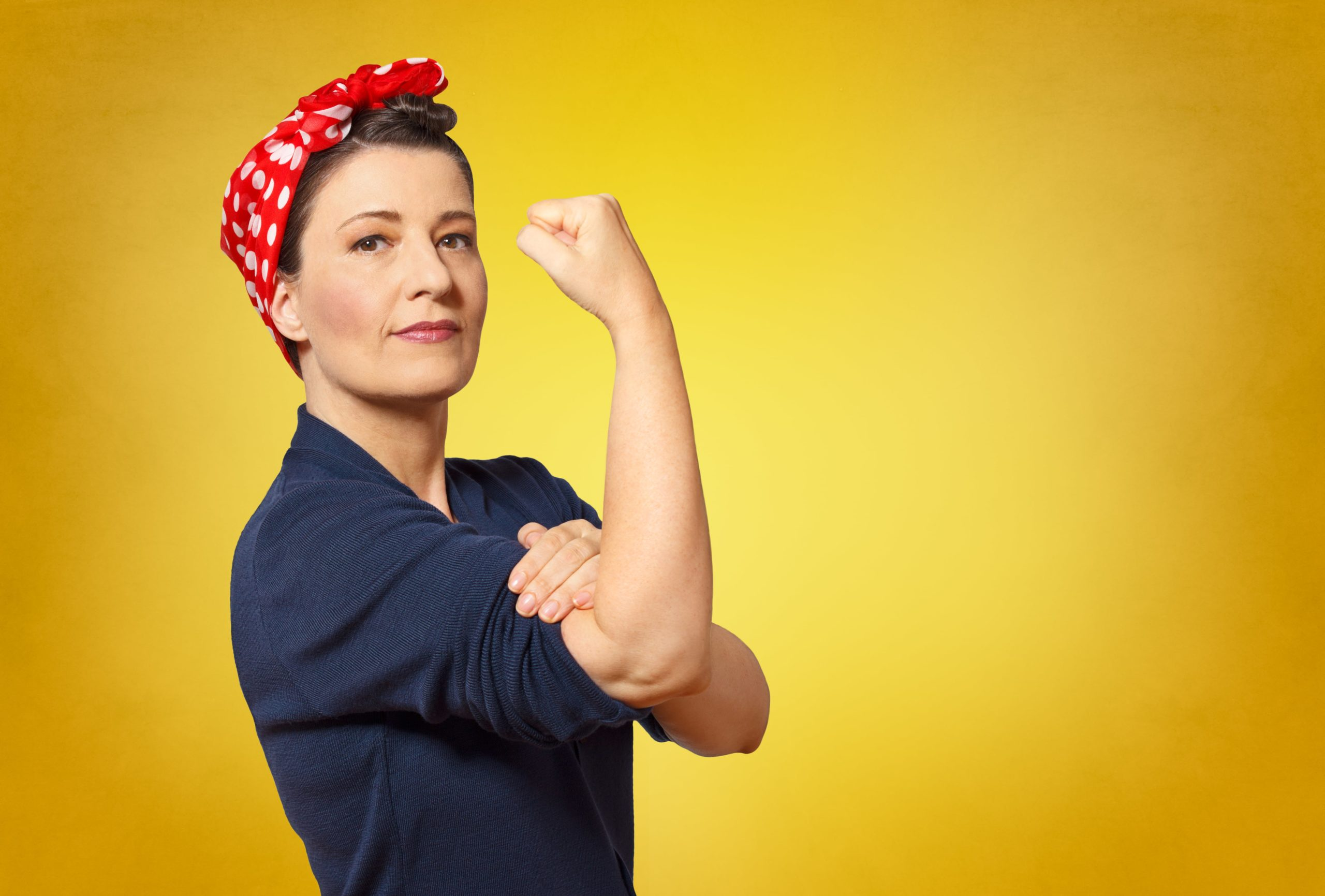 woman dressed as rosie the riveter