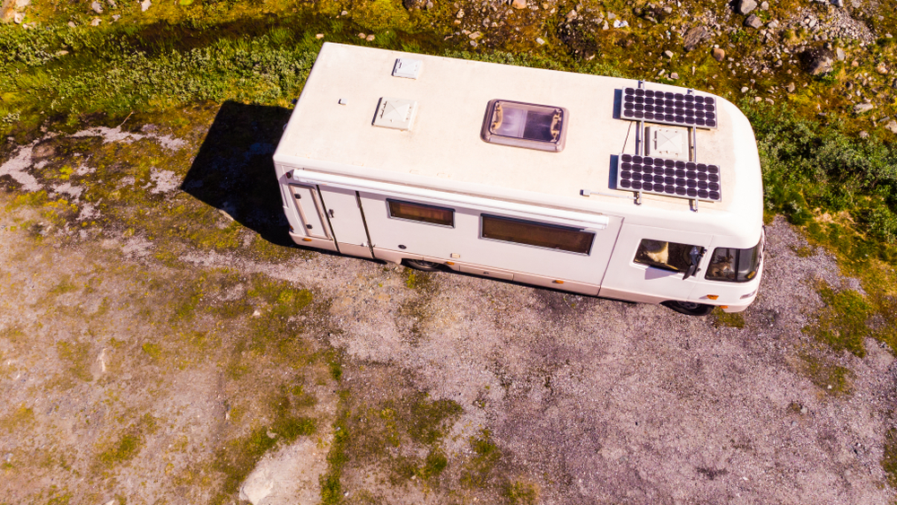 solar panels installed on the roof of an old RV