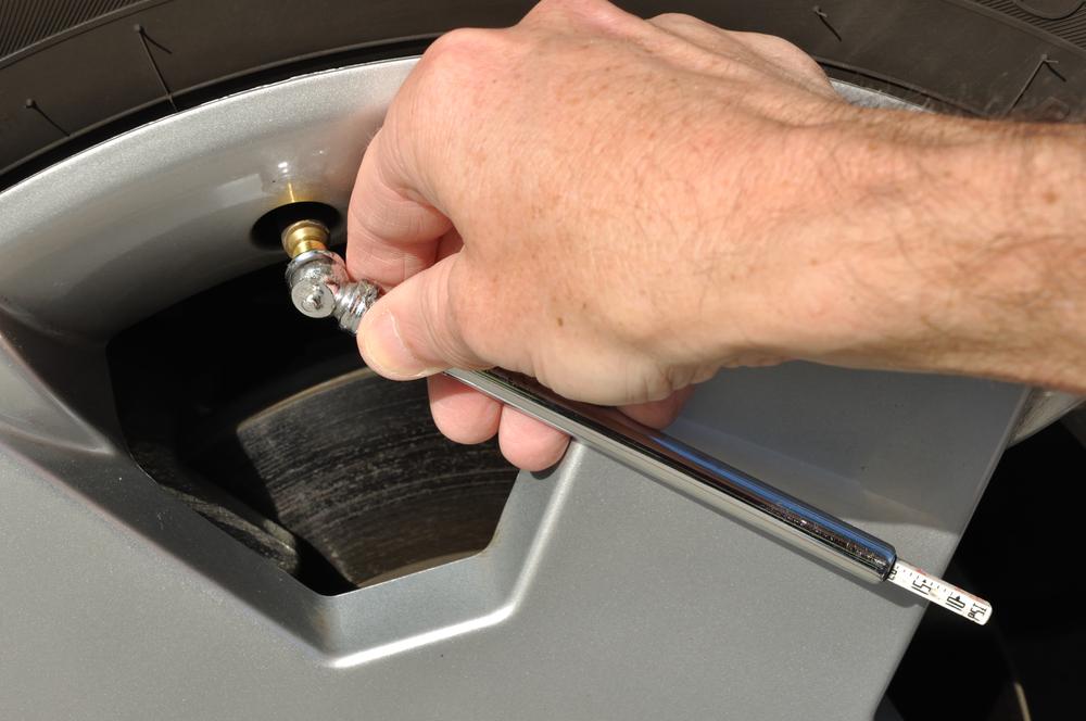 Stick tire pressure gauge in a tire