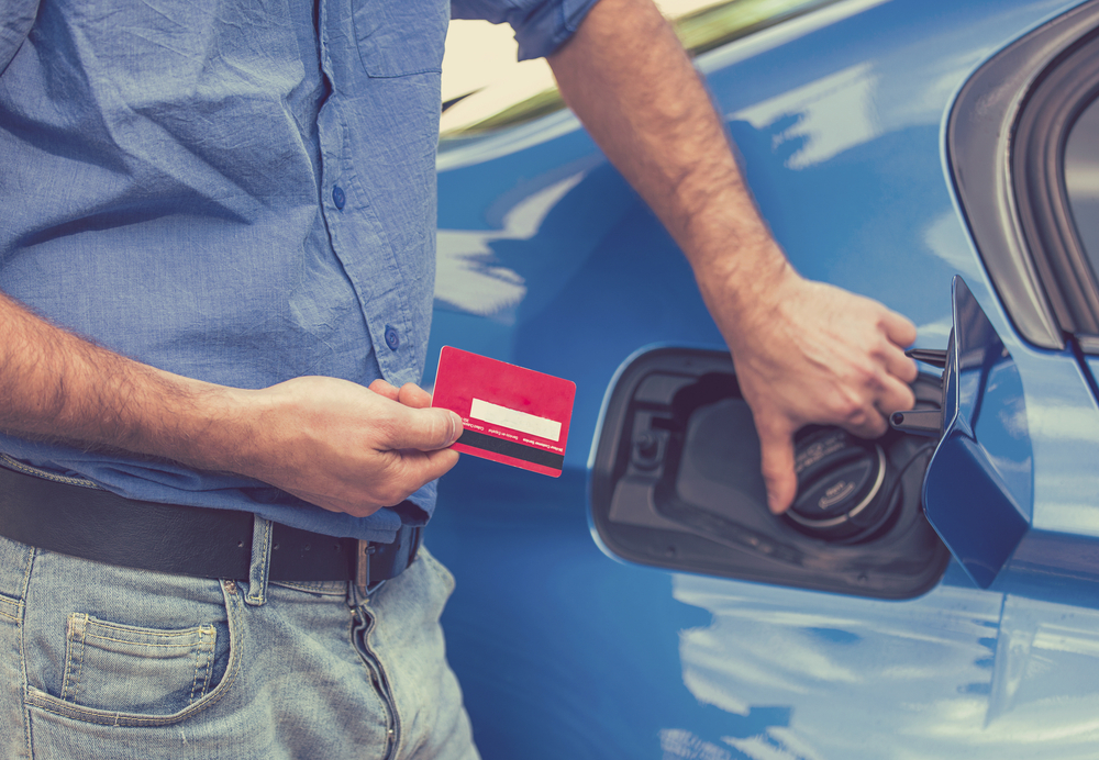 Driver with credit card ready to open the gas cap