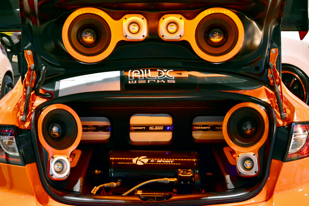 Custom car audio system with four subwoofers and multiple amplifiers