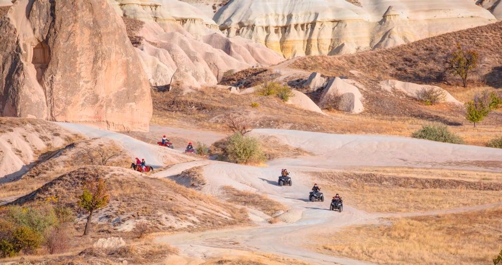 quads riding in the desert