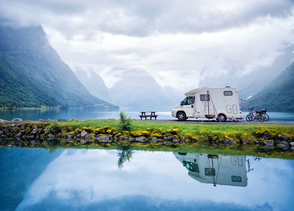 Fiberglass RV with fresh wax by a lake