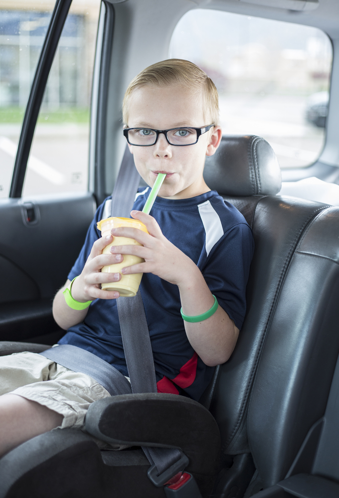 Boy in a backless booster seat