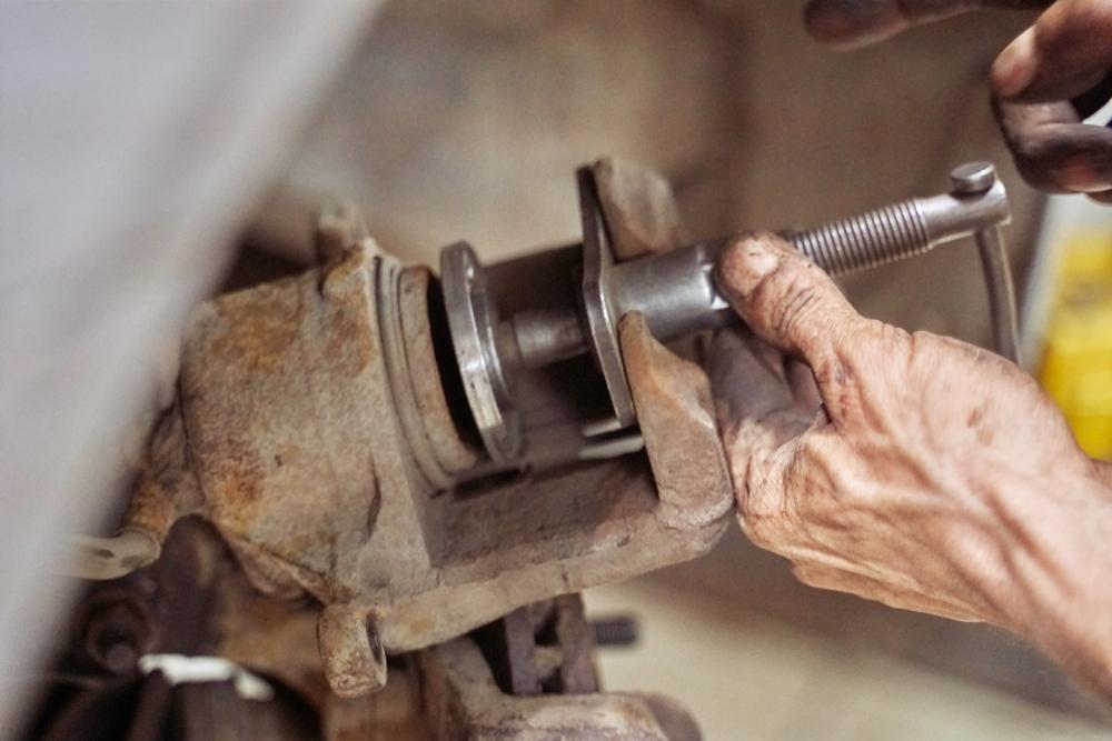 mechanic fixing car brakes