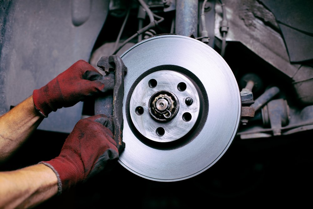 man changing brake pads