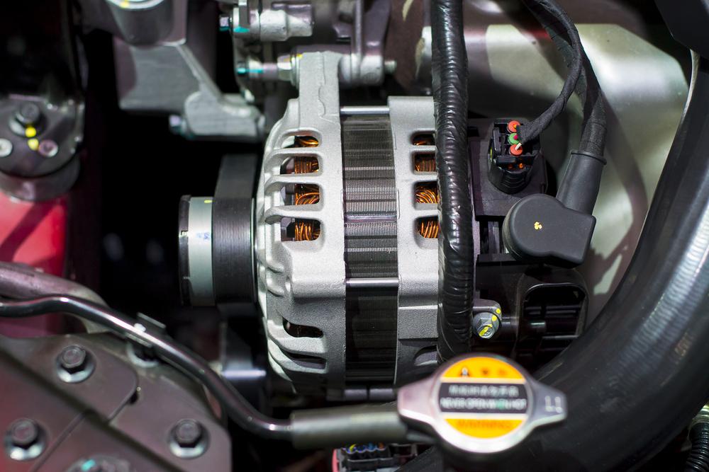 a car's starter motor under the hood