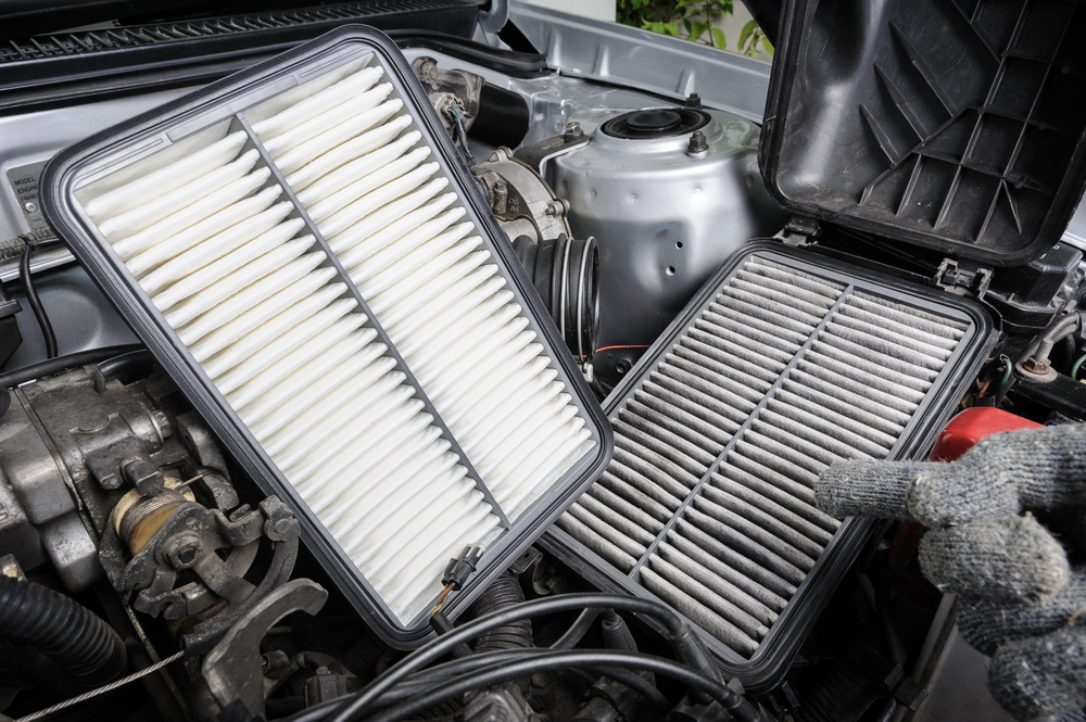 a clean air filter next to a dirty air filter