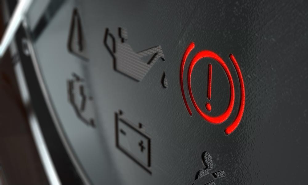 car dashboard with brake light illuminated