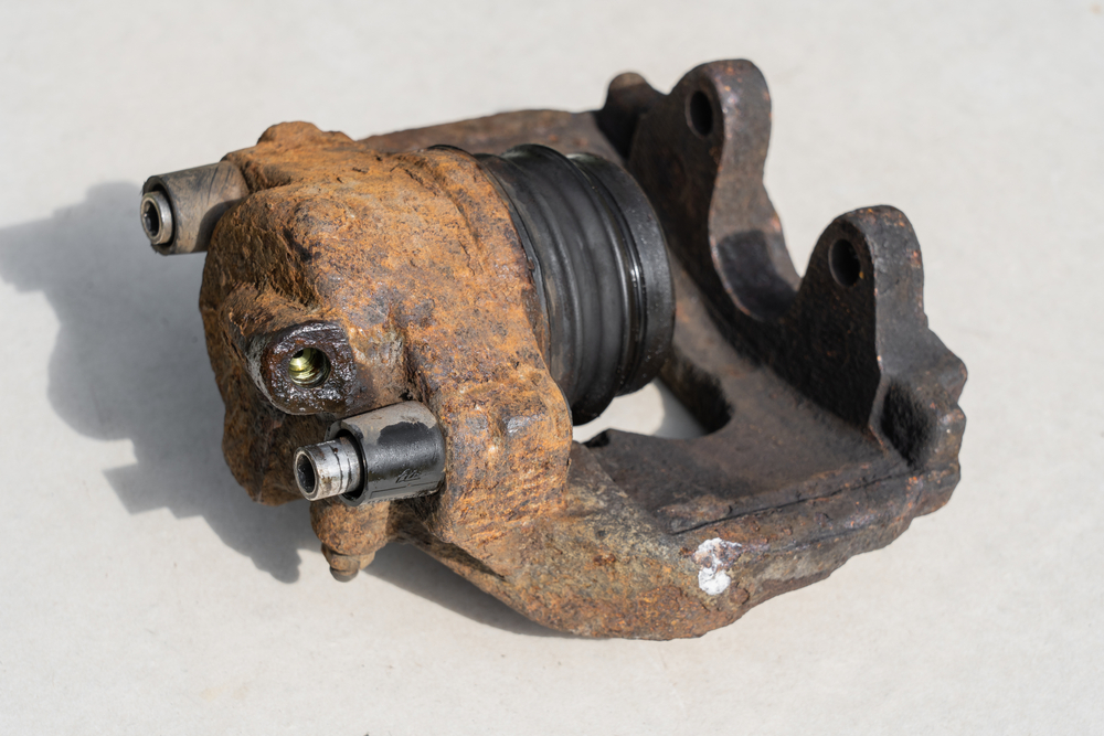 dirty brake caliper with the piston fully extended