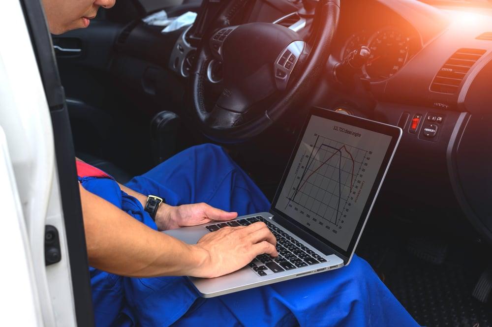 mechanic using a computer for diagnostics