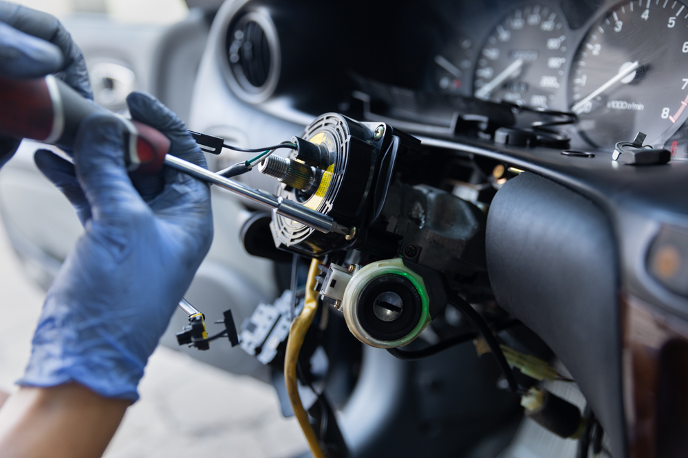 person working on internal steering wheel components