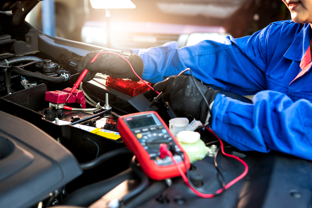 technician using multimeter to check electrical