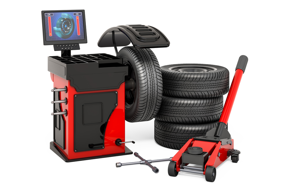 Tire balancing machine with 4 tires