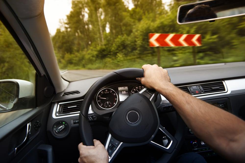 driver turns steering wheel