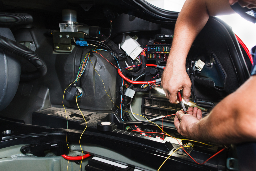 working on a car's complicated electrical
