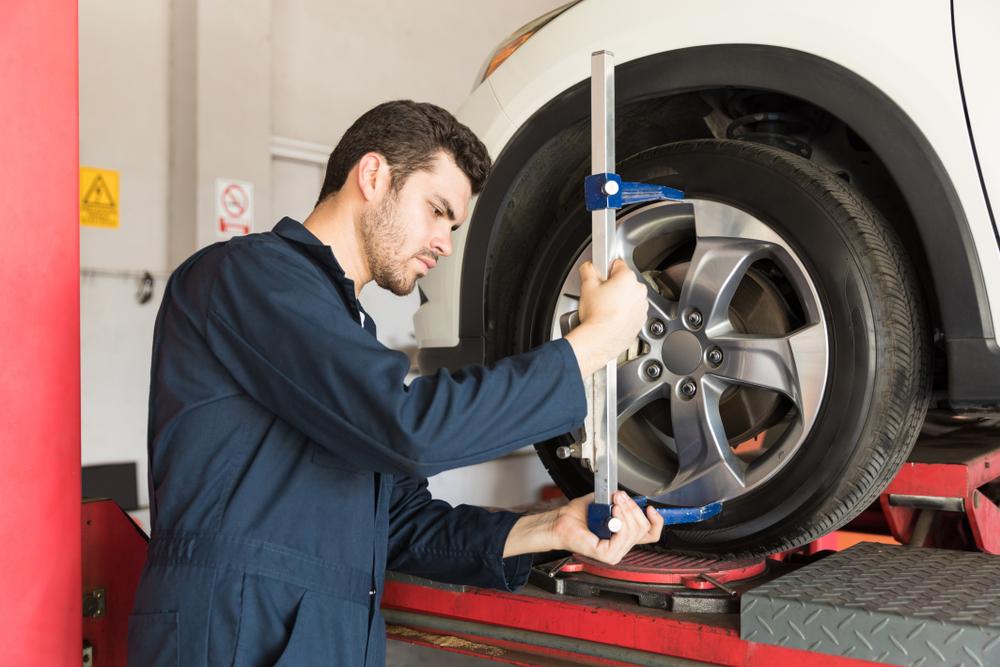 mechanic adjusting camber