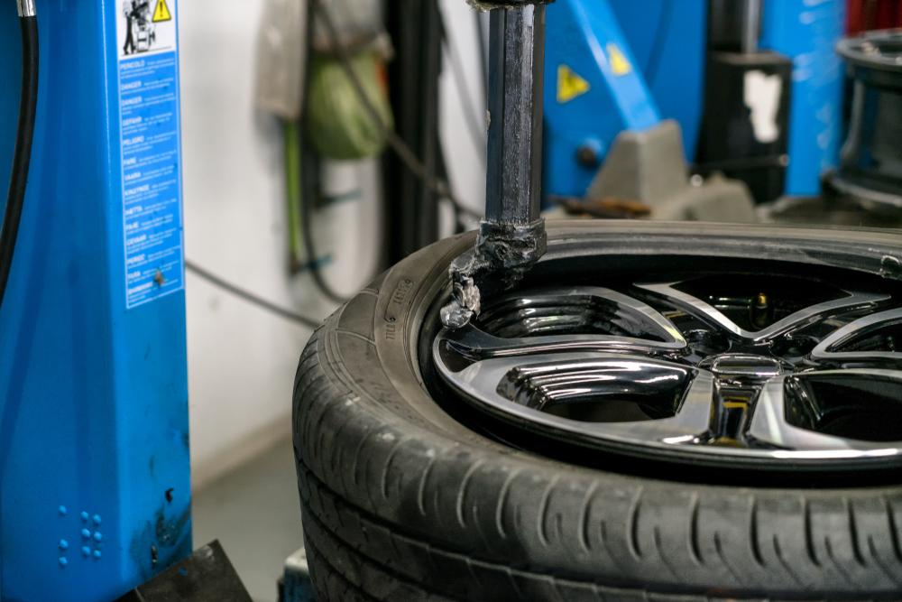 mechanic replacing tpms sensor
