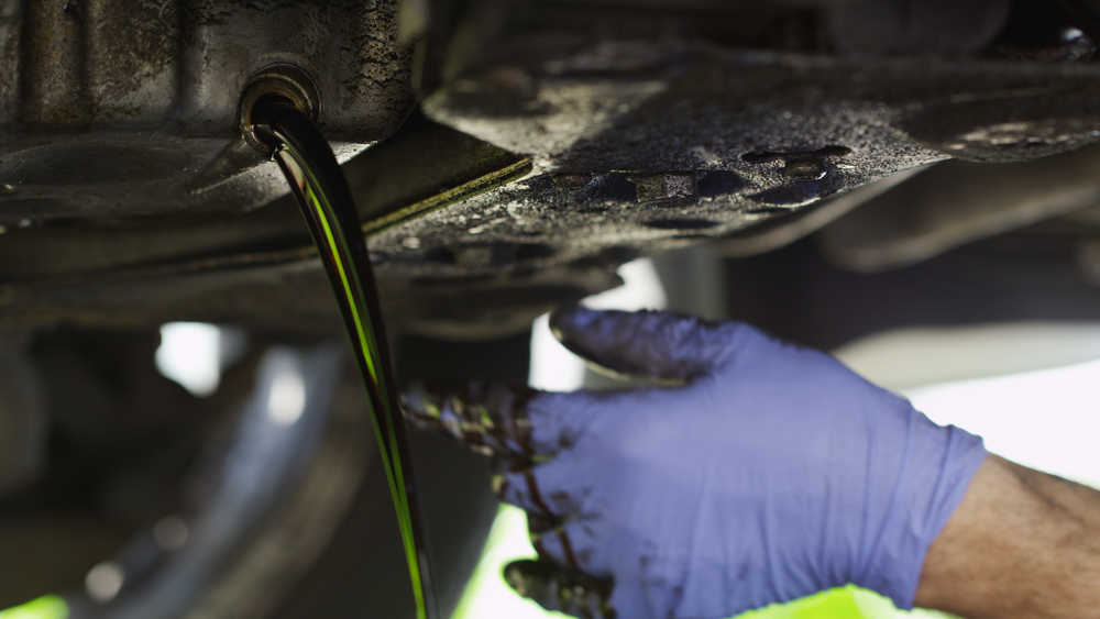 dirty oil pouring out of engine block